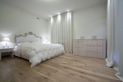 Bedroom. Interior of designer bedroom in classic style Royalty Free Stock Photo
