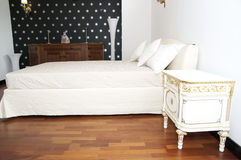 Bedroom. Bright bedroom with a queen size bed and cupboard Royalty Free Stock Image