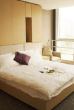 Bedroom. Double bed with bedstand and reading lamp royalty free stock image