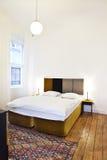 Bedroom. Modern bedroom with hardwood flooring royalty free stock images