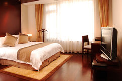 Bedroom. Cozy bedroom with modern decoration Royalty Free Stock Image