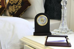Bedroom. With larm clock and lamp Royalty Free Stock Photo