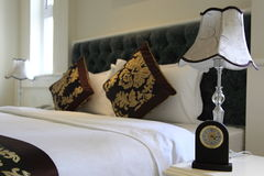 Bedroom. With larm clock and lamp royalty free stock photos