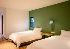 Bedroom. A view of a comfortable, well-furnished hotel bedroom Stock Images