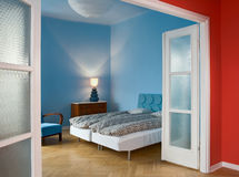 Bedroom. Blue bedroom in the flat Royalty Free Stock Photos