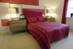 Bedroom. Interior of modern bedroom in red and white Royalty Free Stock Photography