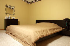 Bedroom. A master bedroom finished in malm style Royalty Free Stock Photos