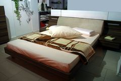 Bedroom. Modern bedroom interior with bed and cushions Royalty Free Stock Images
