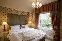 Bedroom. Beautifull sumptuous country house style bedroom stock photo