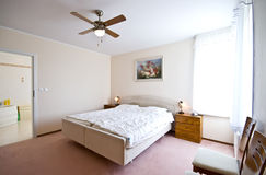 Bedroom. An elegant bedroom in a modern house Royalty Free Stock Images