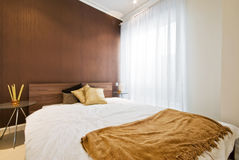 Bedroom. With double bed in brown colors Royalty Free Stock Photos