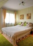Bedroom. Modern bedroom with green tones Royalty Free Stock Photo