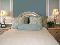 Bedroom. Luxurious bedroom in soft pastel colors stock photography