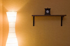 Bedroom. With lamp and clock Stock Photo