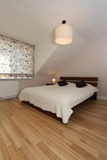 Bedroom on the attic Stock Photography
