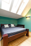 Bedroom in the attic Stock Photography