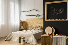 Bedroom with autumn-inspired interior Stock Photos