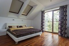 Bedroom with balcony Stock Images