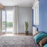 Bedroom with balcony Stock Photography