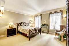 Bedroom with beautiful carved wood bed Royalty Free Stock Photos