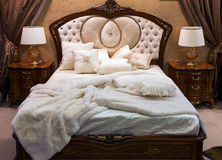 Bedroom with bed in baroque style Royalty Free Stock Photos
