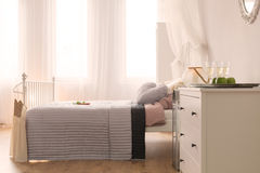 Bedroom with bed and dresser Royalty Free Stock Photography