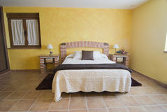 Bedroom with a bed made of bricks. Stock Images