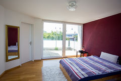 Bedroom with big window Royalty Free Stock Photo