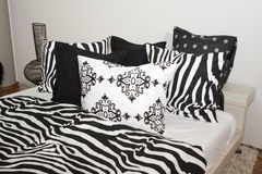 Bedroom with black and white pillows. Details of the interior of a bedroom with black and white bed linens pillows royalty free stock image