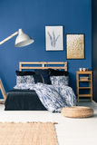 Bedroom with blue wall royalty free stock photography