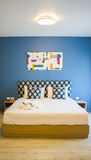 Bedroom with blue wall and wood floor Royalty Free Stock Photography