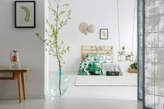 Bedroom with branch in vase royalty free stock images