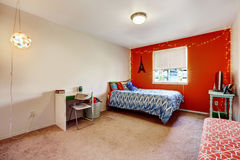 Bedroom with bright red wall Stock Photography