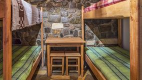 Bedroom in a Wooden Chalet. Bedroom with bunk beds in a wooden chalet Stock Images