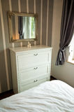 Bedroom cabinet with drawers and mirror Stock Images