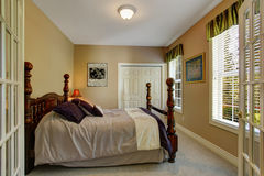 Bedroom with carved wood bed Royalty Free Stock Photo