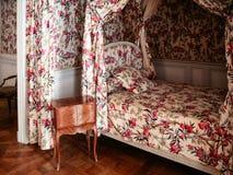 Bedroom in castle Chateau de Chambord in Frace. CHAMBORD, FRANCE - JULY 7, 2010: bedroom in castle Chateau de Chambord. Chambord is the largest chateau in the Stock Photos