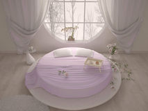Bedroom with a circular window and bed Royalty Free Stock Photos