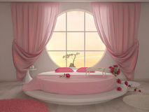 Bedroom with a circular window Stock Images