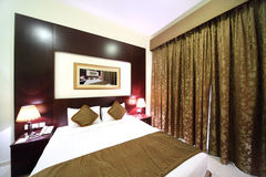 Bedroom with closed curtain and big bed Royalty Free Stock Photography