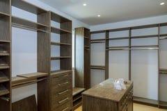 Large wardrobe closet, with empty shelves. Bedroom closet with storage bins and shelves large wardrobe closet, with empty shelves stock photo
