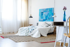 Bedroom with colorful artwork stock images