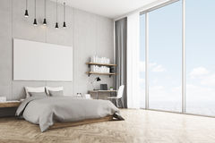 Bedroom with concrete wall and wooden floor Stock Photo