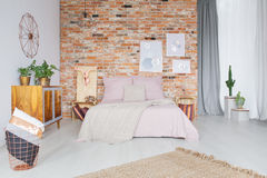 Bedroom with copper accessories Stock Photos