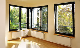 Bedroom with corner windows. And sun rights Royalty Free Stock Photos