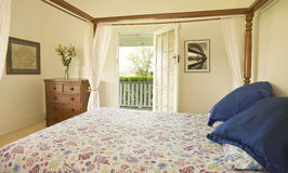 Bedroom Door Widow View. A bedroom in a country home with a view out the door Stock Photos