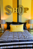 Bedroom. Cozy bedroom with bed and night stands Royalty Free Stock Photos