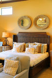 Bedroom. Cozy bedroom with bed and night stands Royalty Free Stock Photography