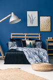 Bedroom with cyan wall. And wooden furniture royalty free stock photo