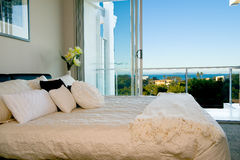 Bedroom decor. Bedroom looking out over the ocean Royalty Free Stock Photography